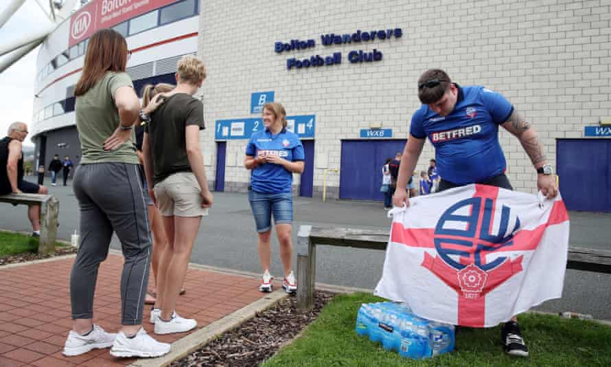 Fans gather at the University of Bolton Stadium to wait for news.