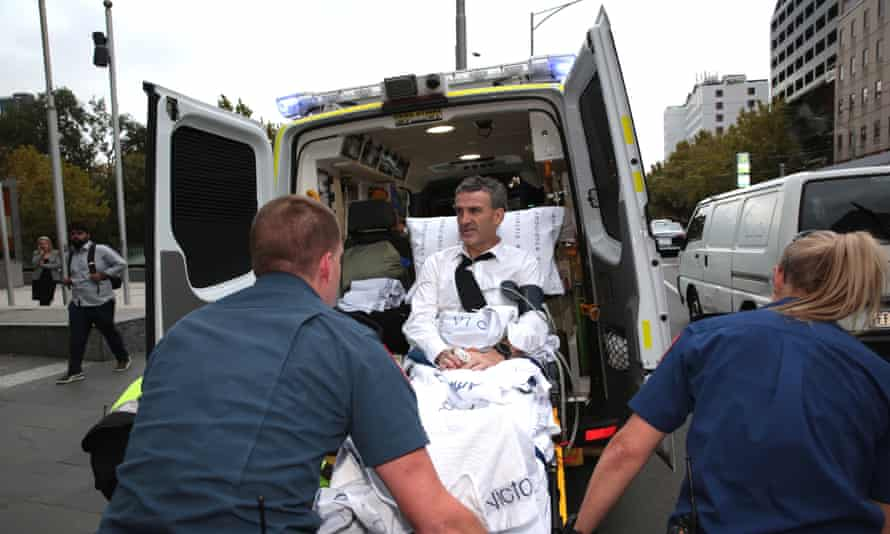 Dover Financial Services responsible manager and owner Terry McMaster is placed in an ambulance after collapsing in the stand at the banking royal commission.