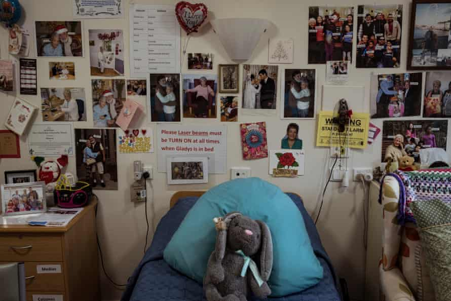Gladys room is adorned with labelled photographs and cues to assist with her dementia.