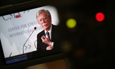 John Bolton is seen in a video camera screen as he delivers remarks at a Washington think tank.