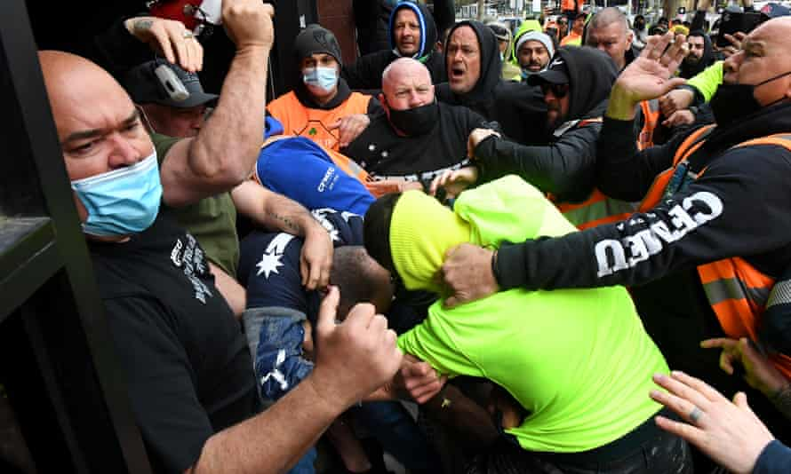 Construction workers clash with trade unionists during a protest at CFMEU headquarters in Melbourne on Monday