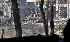 Syrian pro-government forces patrol a neighbourhood of Aleppo