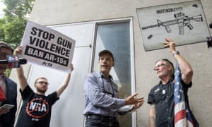 The NRA member Jim Whelan, center, with protesters outside the NRA's annual meeting in Dallas on 4 May.