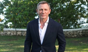 Daniel Craig poses for a picture during a photocall for No Time to Die