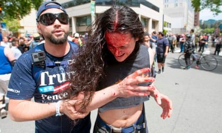 A Trump supporter assists an injured man.