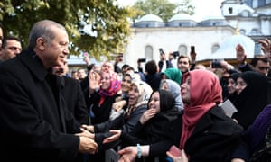 Turkey's pater familias: President Erdoğan talks with citizens after performing dawn prayer at the Eyup Sultan mosque in Istanbul.