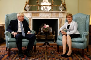 Boris Johnson poses for a photograph with Nicola Sturgeon at Bute House in Edinburgh on 29 July 29