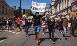 Activists march along Whitehall, London, while holding placards during the George Floyd demonstration.