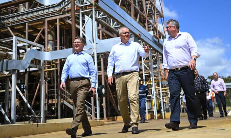 Prime Minister Scott Morrison (centre) visits. an oil refinery in Gladstone, Queensland, in January.