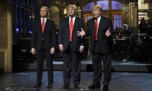 … Donald Trump (centre) guest hosts Saturday Night Live in 2015.