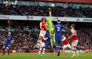 Arsenal's Bernd Leno tries and fails to punch the ball clear.