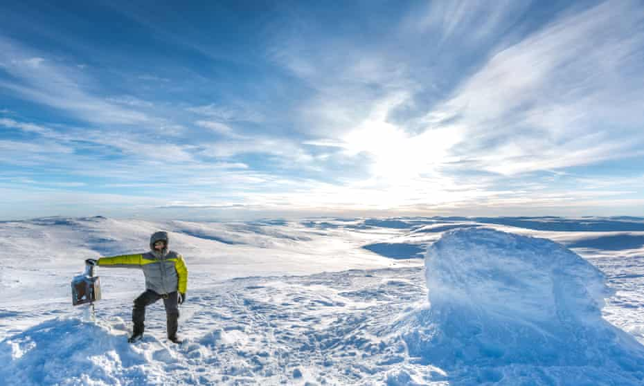 A climber takes in the view from the summit of Halti.