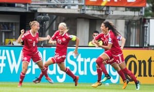 Theresa Nielsen, left, and her team-mates celebrate her winning goal against Germany.