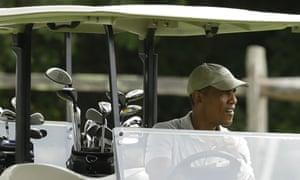 President Obama drives a golf cart