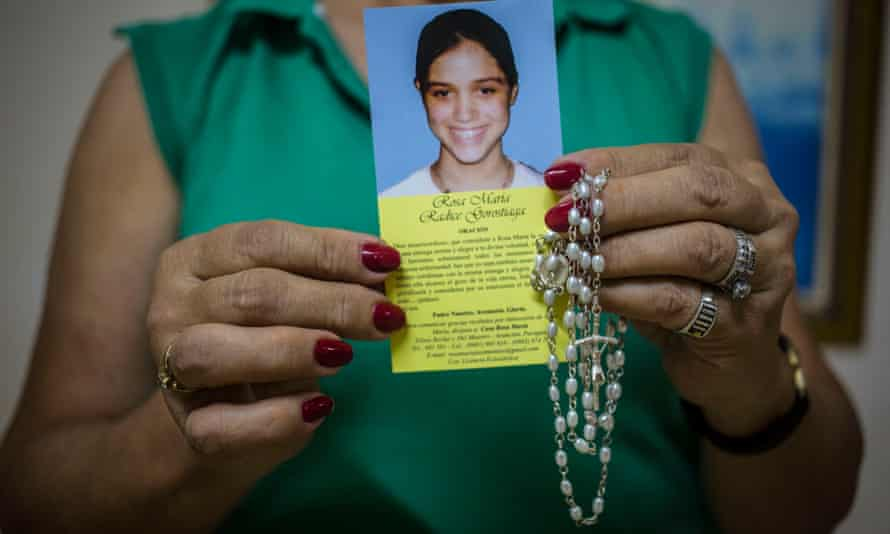 A volunteer at the Rosa María children's shelter in Asunción shows a leaflet about the hospice