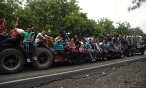 Honduran migrants take part in a caravan towards the United States in Chiquimula, Guatemala, on 17 October.