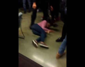 For a brief moment, the young woman remained limp on the ground before the officer lifted her up and walked her out of view of the camera.