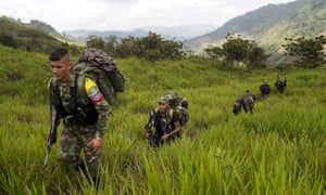 Members of the 36th front of the Revolutionary Armed Forces of Colombia, or Farc, trek to a new camp in Antioquia state, in the north-west Andes of Colombia.