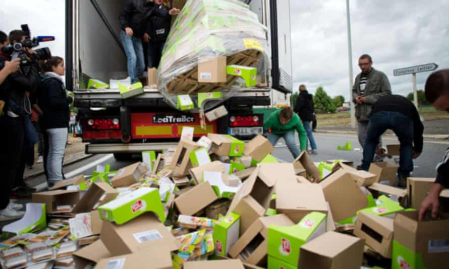 Farmers unload packages of food