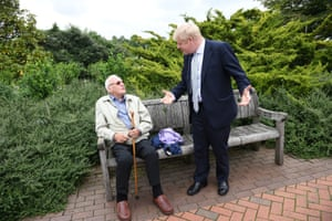 Johnson talks to a visitor as he tours Wisley.