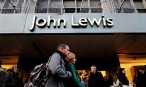 Shoppers pass a John Lewis store
