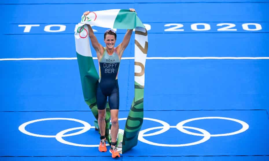 Flora Duffy of Bermuda celebrates after winning the Olympic triathlon – and her country's first Olympic gold medal.