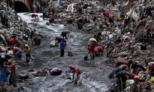 People scavenge at a garbage dump in Guatemala City.