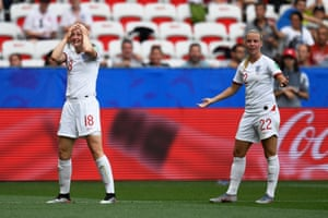 England's forward Ellen White (L) reacts after a goal was ruled offside.
