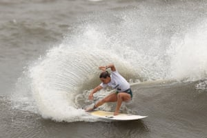 Surfer Sally Fitzgibbons performs a roundhouse cutback during the women's quarter final