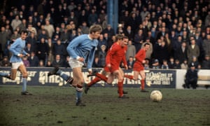 Colin Bell eats up the turf on a breakaway move for Manchester City.