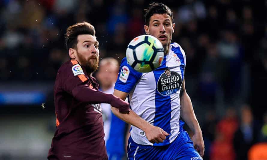 Fabian Schar battles with Lionel Messi in La Liga