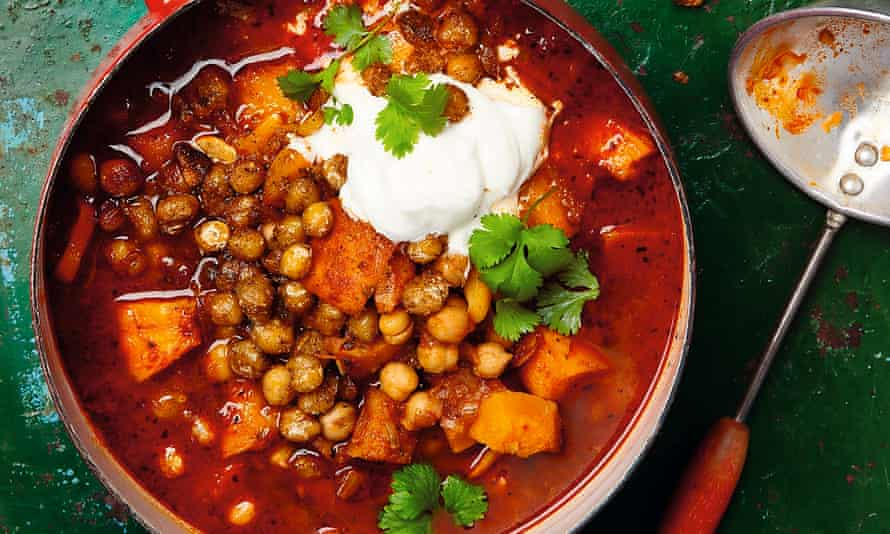 Photograph of Yotam Ottolenghi's roasted pumpkin soup with harissa and crisp chickpeas