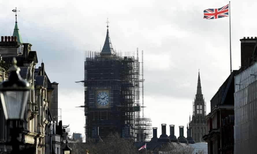 Big Ben covered in scaffolding, Union Jack flag nearby