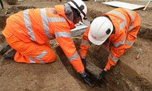 Archaeologists remove the breastplate of Captain Matthew Flinders during workg on London's HS2 high-speed rail project at Euston