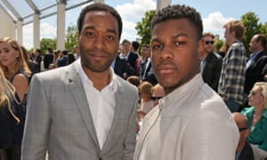 Chiwetel Ejiofor (L) and John Boyega attend the front row at Burberry Menswear Spring/Summer 2016 show