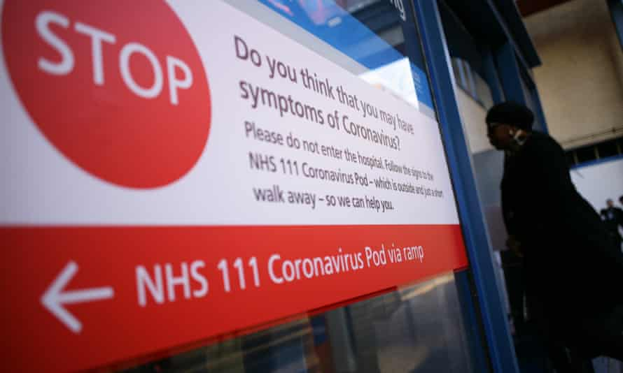 A sign directing people with symptoms of Covid-19 to an isolation unit at St Mary's hospital in London in March 2020
