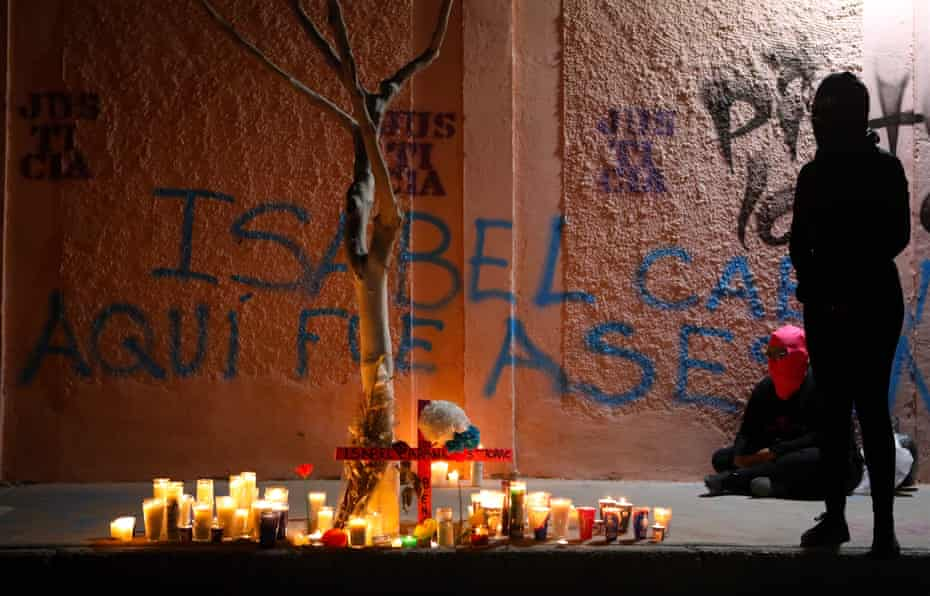 Activists place candles during a protest against femicides in Ciudad Juarez and the murder of 26-year-old artist, activist and feminist Isabel Cabanillas de la Torre, also killed in the city, in Ciudad Juarez, in the state of Chihuahua, Mexico, on January 25, 2020.