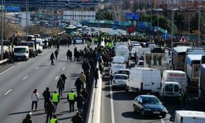 Taxi drivers protest on the M40 highway in Madrid during a protest.