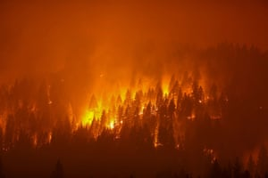 Taylorsville, USThe Dixie fire, stretching over 200,000 acres, burns at night in California