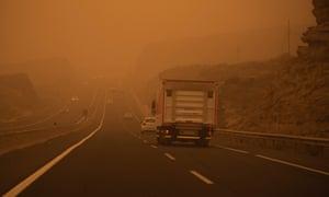 Cars on the TF-1 highway during a sandstorm in Santa Cruz de Tenerife on Sunday.