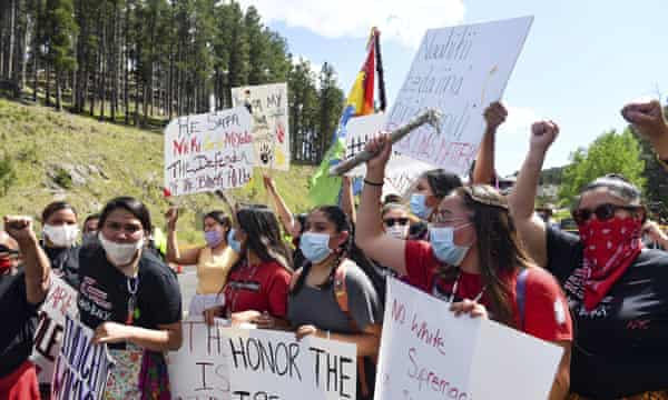 Protesters on the road leading to Mount Rushmore, where Donald Trump gave a speech in July 2020.