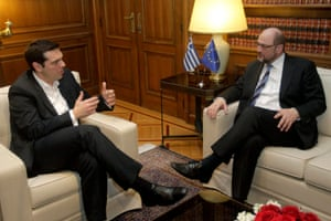 New Greek Prime Minister Alexis Tsipras (L) talks with Martin Schulz (R), President of the European Parliament, during their meeting in Athens, Greece, 29 January 2015.