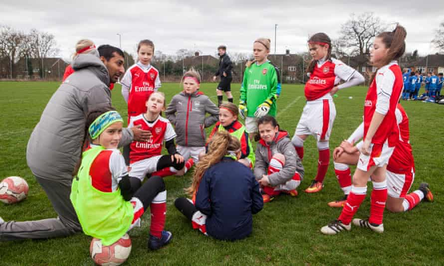 The Arsenal coach Rupen Shah, here addressing the team at half-time, says: 'You really see the benefits. I asked the girls recently what they thought and they unanimously said they would prefer to play in a boys league.'