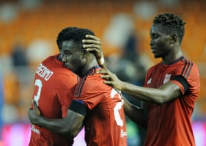 Lyon's Henri Bedimo Nsame, left, Maxwel Cornet, centre, and Mapou Yanga-Mbiwa celebrate after their 2-0 win victory over Valencia.