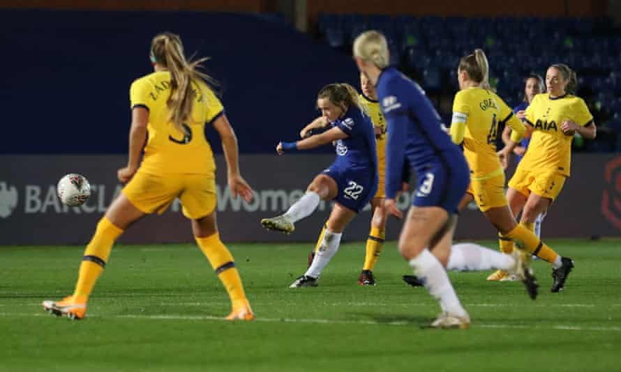 Erin Cuthbert opens the scoring with a shot from the edge of the penalty area despite being surrounded by players.