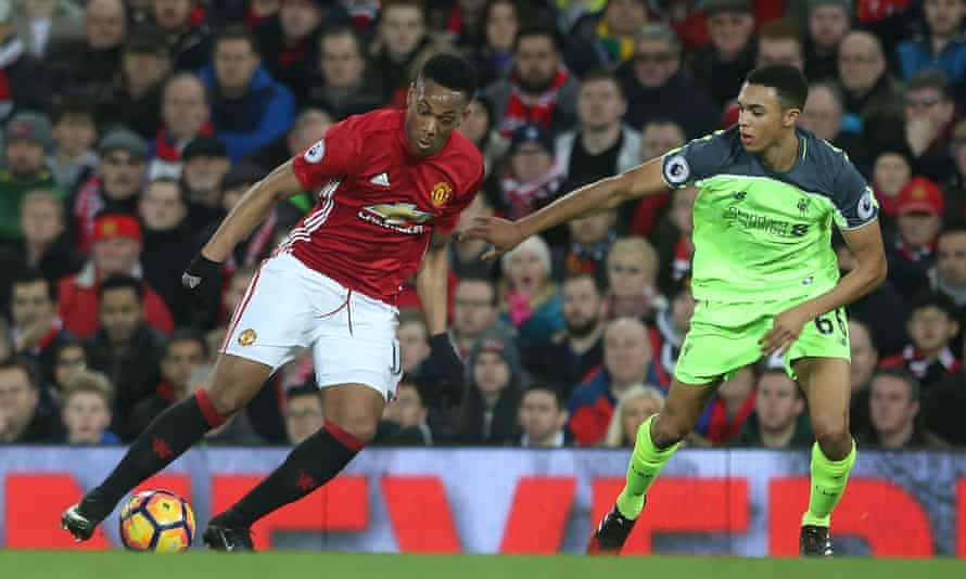 Manchester United's Anthony Martial, left, prepares to take on Trent Alexander-Arnold of Liverpool in this month's 1-1 draw.