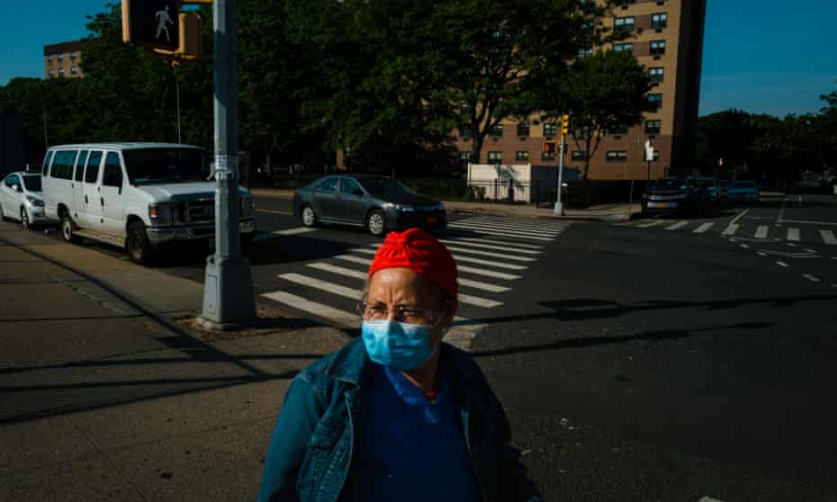 A woman wearing a mask in Corona, Queens.