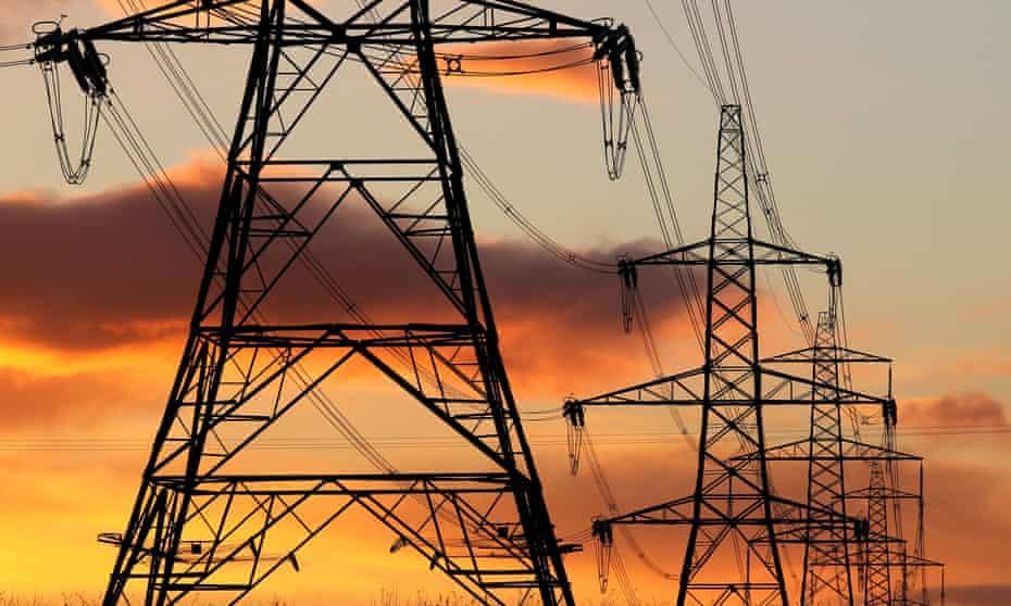 Electricity pylons at sunset near Denny, Falkirk.