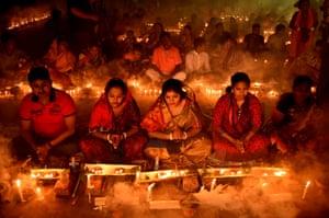 Devotees pray at a temple during the Rakher Upobash, a Hindu religious fasting festival. Narayanganj, Bangladesh