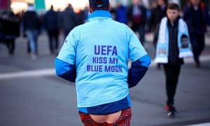 A Manchester City fan wears a shirt protesting against Uefa before March's Carabao Cup final.